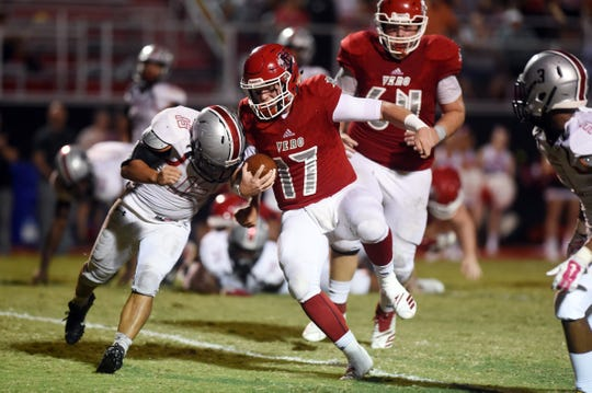 Vero Beach High School quarterback Nick Celidonio moves the ball up the field for a touchdown on Friday, Nov. 9, 2018 during a Region 2-8A quarterfinal playoff game angst Gateway at the Citrus Bowl in Vero Beach. The Fighting Indian won the game 48-6.