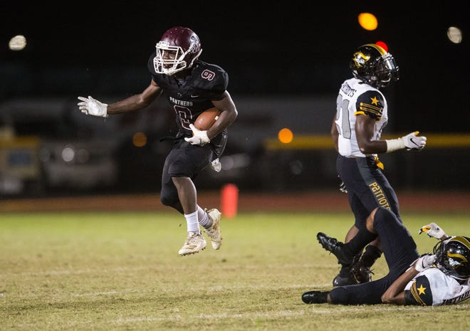 Fort Pierce Westwood's Antonio Green hops up after completing a big reception in the third quarter against American Heritage (Plantation) during the high school football game Friday, Nov. 9, 2018, at Lawnwood Stadium in Fort Pierce.