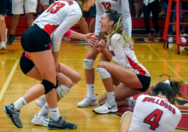 South Fork's Angela Grieve (14) celebrates with teammates after scoring the winning point Saturday, Nov. 10, 2018, to defeat Barron Collier (Naples) 3-2 during their high school state semi-final volleyball match at South Fork High School in Tropical Farms.
