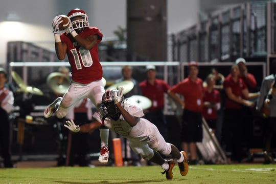 Vero Beach High School's Demarcus Harris hauls in a catch for a touchdown on Friday, Nov. 9, 2018 during a Region 2-8A quarterfinal playoff game against Gateway at the Citrus Bowl in Vero Beach. The fighting Indians won 48-6.