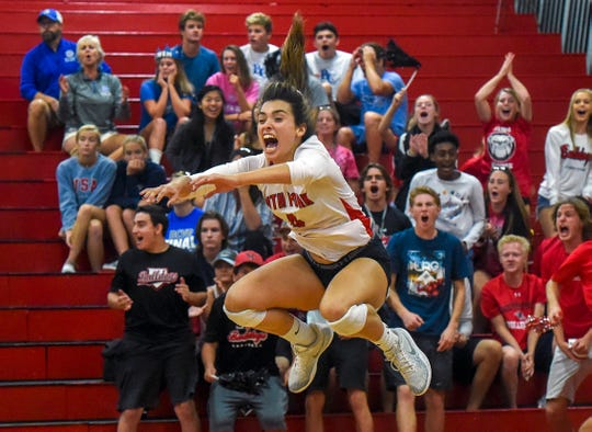 South Fork's Gracee Carpino (4) celebrates after her team won a set against Barron Collier (Naples) Saturday, Nov. 10, 2018, their high school state semi-final volleyball match at South Fork High School in Tropical Farms. South Fork defeated Barron Collier (Naples) 3-2.