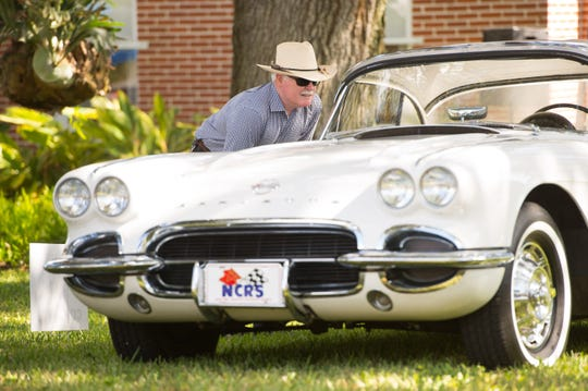 Paul Sinnott of Fort Pierce takes a closer look at Ruth Hallstrom's original 1962 Corvette Saturday, November 10, 2018, on display during the Indian River County Historical Society's fourth annual Party at the Pineapple Plantation at the Hallstrom House in Vero Beach.