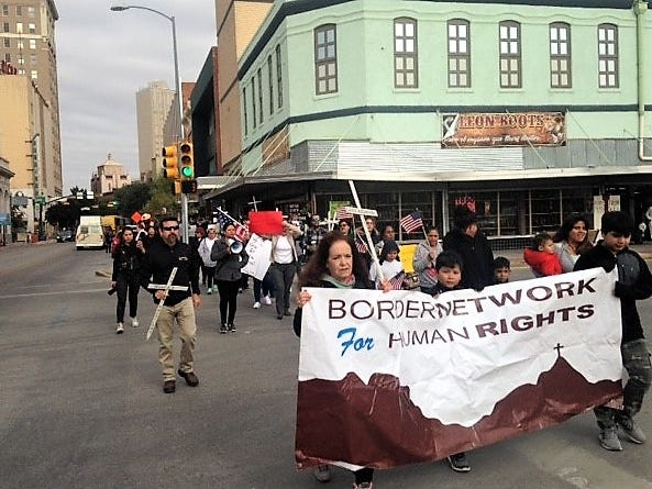 About 100 protesters march Saturday, Nov. 10, 2018, through Downtown El Paso en route to the Chihuahuita neighborhood to protest the Trump administration's immigration policies.