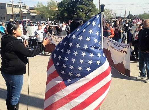 Dulce Carlos, of the Border Network for Human Rights, speaks to about 100 protesters in the Chihuahuita neighborhood near Downtown El Paso during a Saturday, Nov. 10, 2018, protest of President Donald Trump's immigration policies.