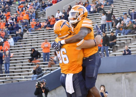 UTEP celebrates a score on Saturday vs. Middle Tennesee.