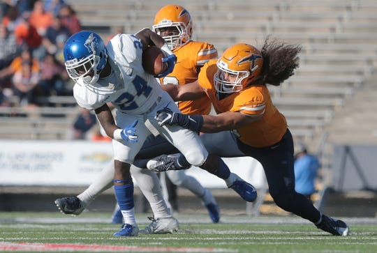 UTEP freshman linebacker Sione Tupou stops Middle Tennessee's Zack Dobson during the game Saturday at Sun Bowl Stadium.