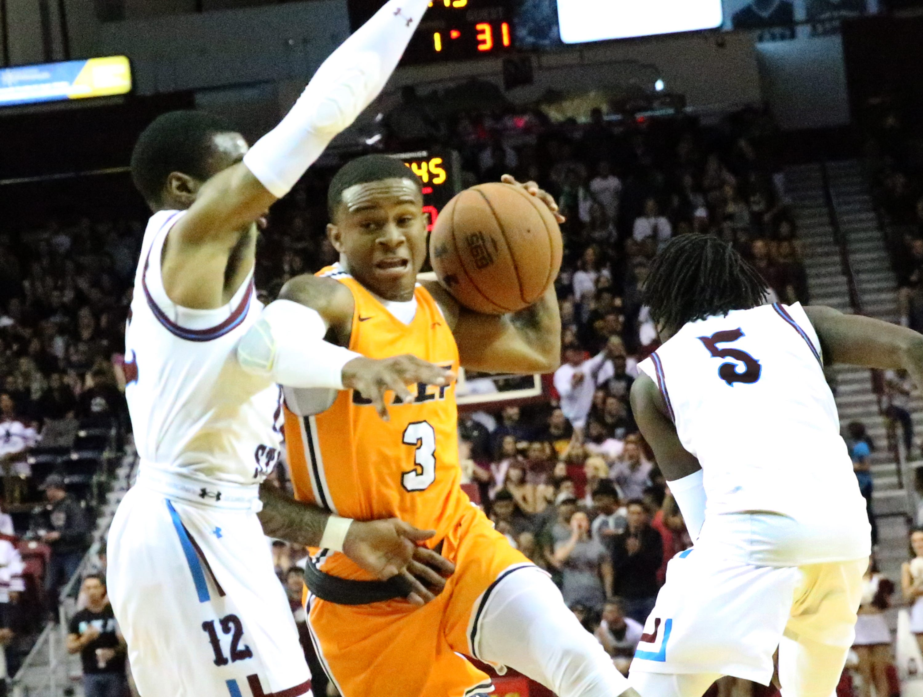 UTEP's Evan Gilyard, 3, drives against NMSU.
