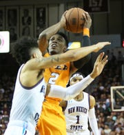 Jodan Lathon, 2, of UTEP takes a shot against NMSU Friday night in the Pan America Center in Las Cruces.