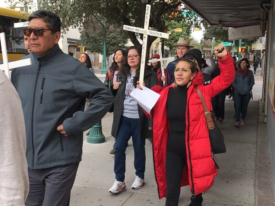 About 100 protesters gathered Saturday morning at San Jacinto Plaza, then marched past the Santa Fe Street Bridge toward Chihuahuita, where a new section of the border wall is being built.