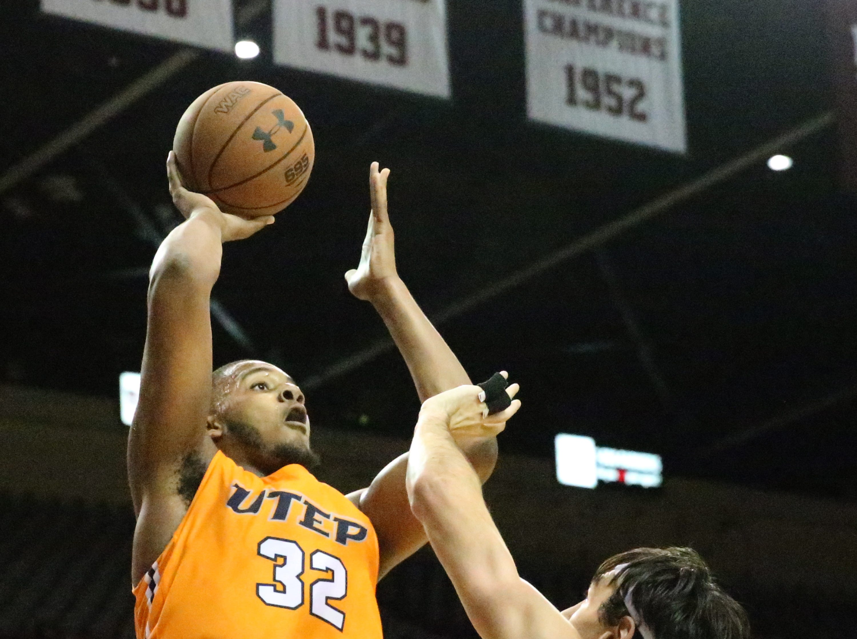 UTEP's Efe Odigie, 32, rises for a shot against NMSU.