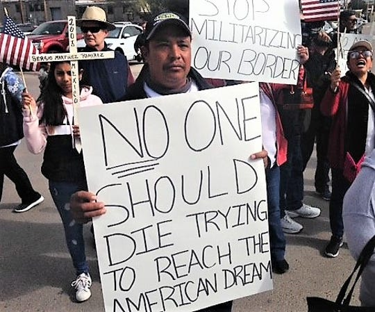 Marcelo Arcinega, 38, of Las Cruces, who immigrated from Mexico to the United States 18 years ago, was one of about 100 protesters who marched Saturday, Nov. 10, 2018, in El Paso to protest President Donald Trump's immigration policies and putting troops on the border.