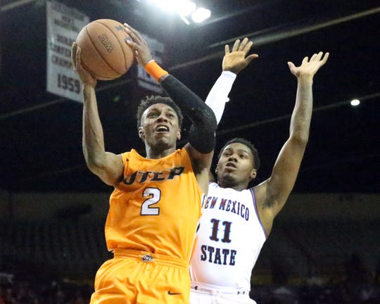Jordan Lathon, 2, of UTEP drives for a shot against Keyon Jones, 11, of NMSU during the I-10 Rivalry Friday night in the Pan American Center in Las Cruces.