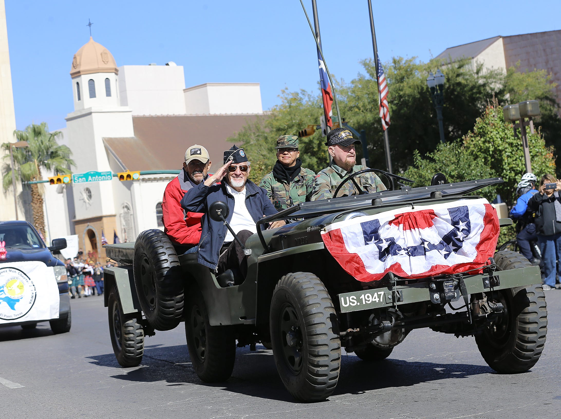A veteran salutes from a Jeep on Saturday in Downtown El Paso during the annual Veterans Day Parade.