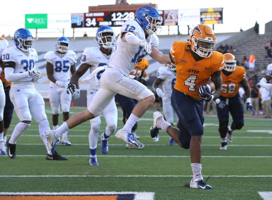 UTEP junior running back Quardraiz Wadley steps into the endzone past Middle Tennessee's Reed Blankenship Saturday at the Sun Bowl. UTEP lost to the Blue Raiders 48-32.