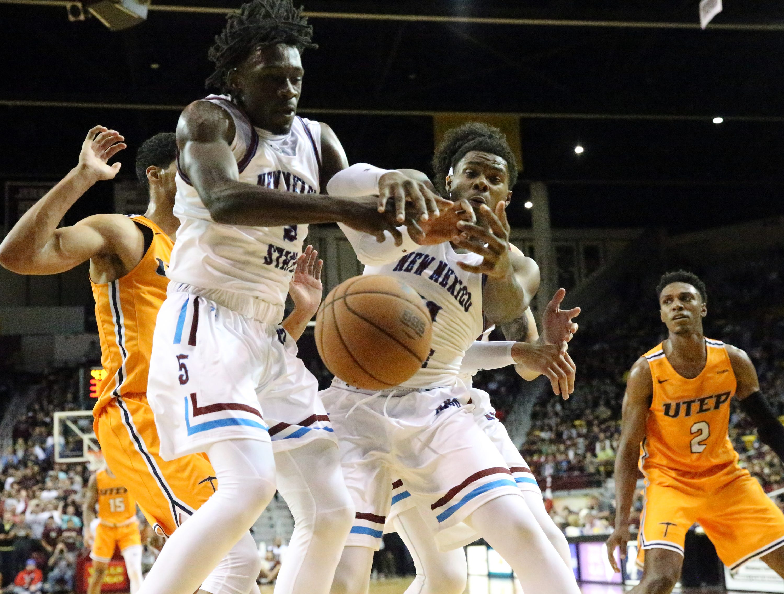 NMSU goes after a rebound under UTEP's basket Friday night.