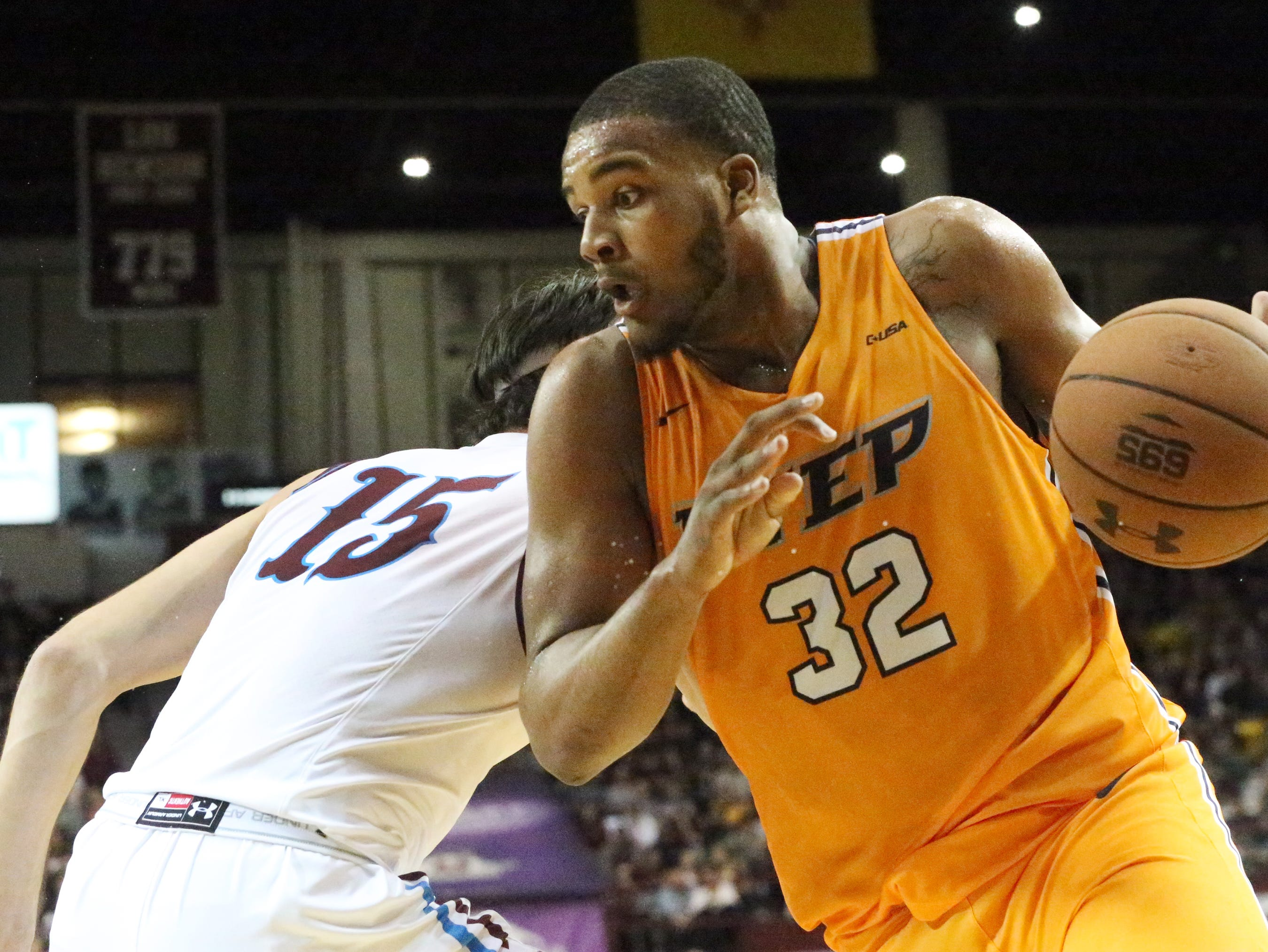Efe Odigie, 32, of UTEP slips past Ivan Aurrecoechea 15, of NMSU Friday night in the Pan American Center.