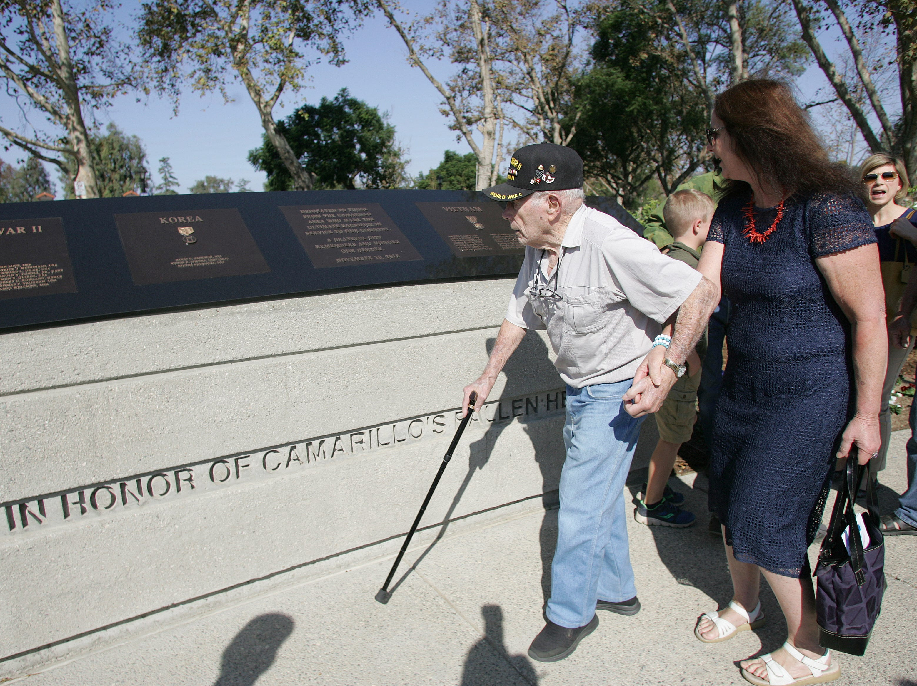 World Word II Army veteran Leonard Utter and Becky Czerwonka walk to the new veterans memorial in Camarillo on Saturday.
