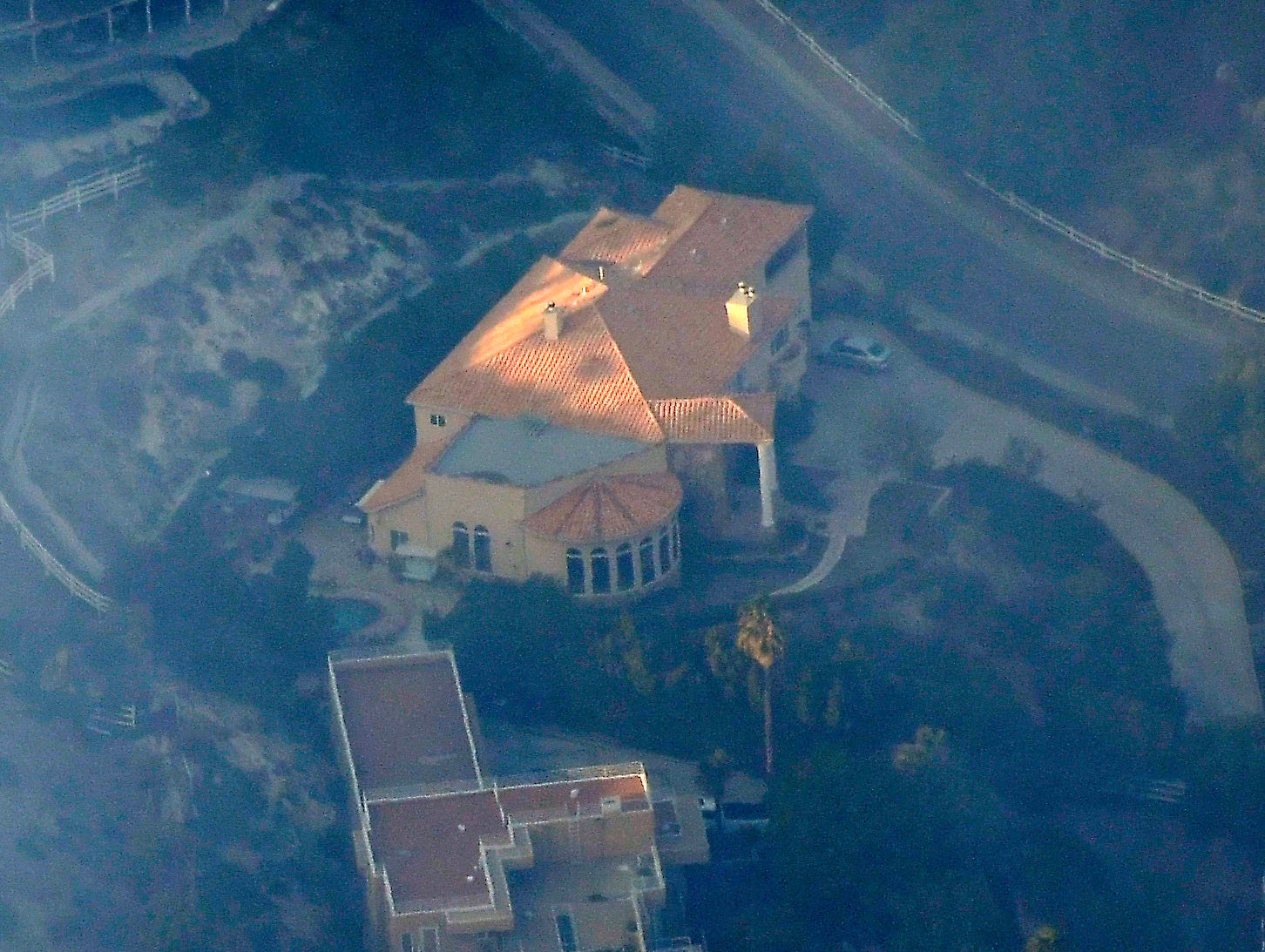 A home burns Friday in Calabasas as the Woolsey Fire races through the community on its way from the Simi Valley area to Malibu.