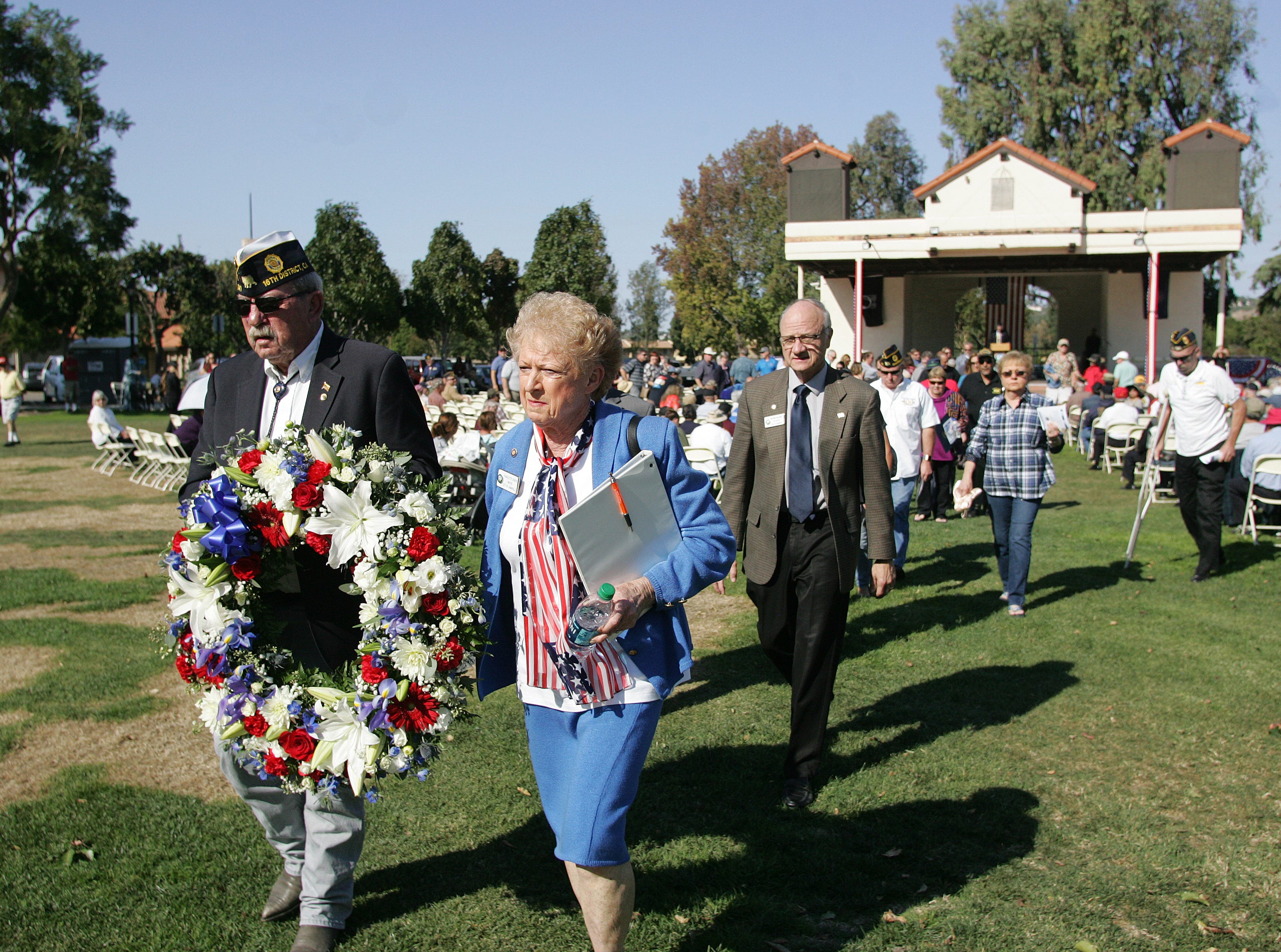 A wreath is carried to the new Veterans Memorial Monument by veteran Dan Crow, who's on the executive committee of American Legion Post 741, and Camarillo Mayor Charlotte Craven on Saturday. The City of Camarillo and American Legion Post 741 hosted a Veterans Memorial Monument dedication ceremony at Constitution Park in Camarillo.
