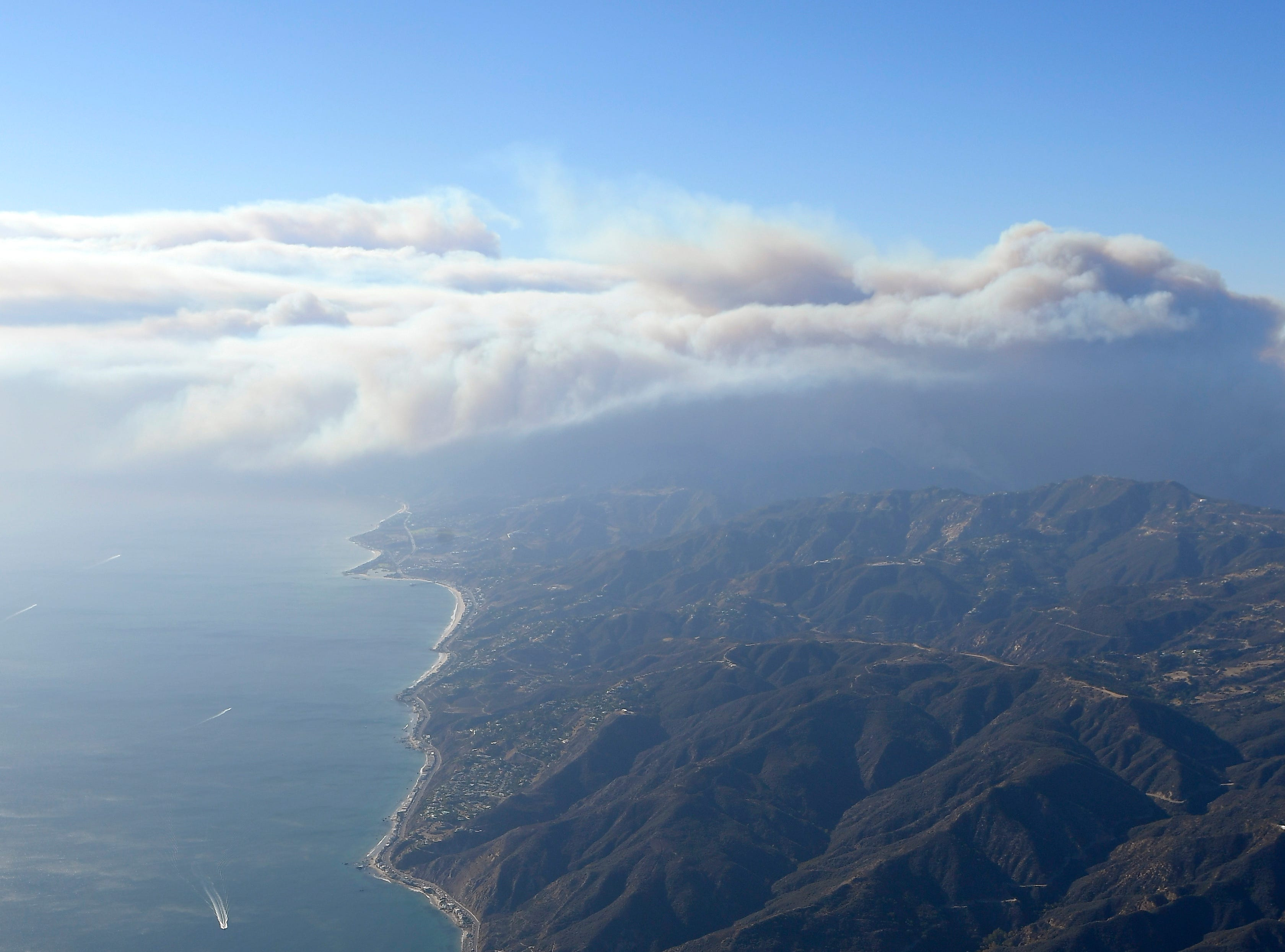 Smoke rises as the Woolsey and Hill fires burn toward the Pacific Ocean on Friday, as seen from a vantage point over Santa Monica.