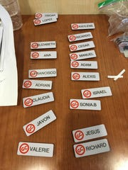 Newly made name badges await some of the 200 employees in training for the opening this week of Golden Corral in Oxnard. The restaurant specializes in all-you-can-eat buffet service.