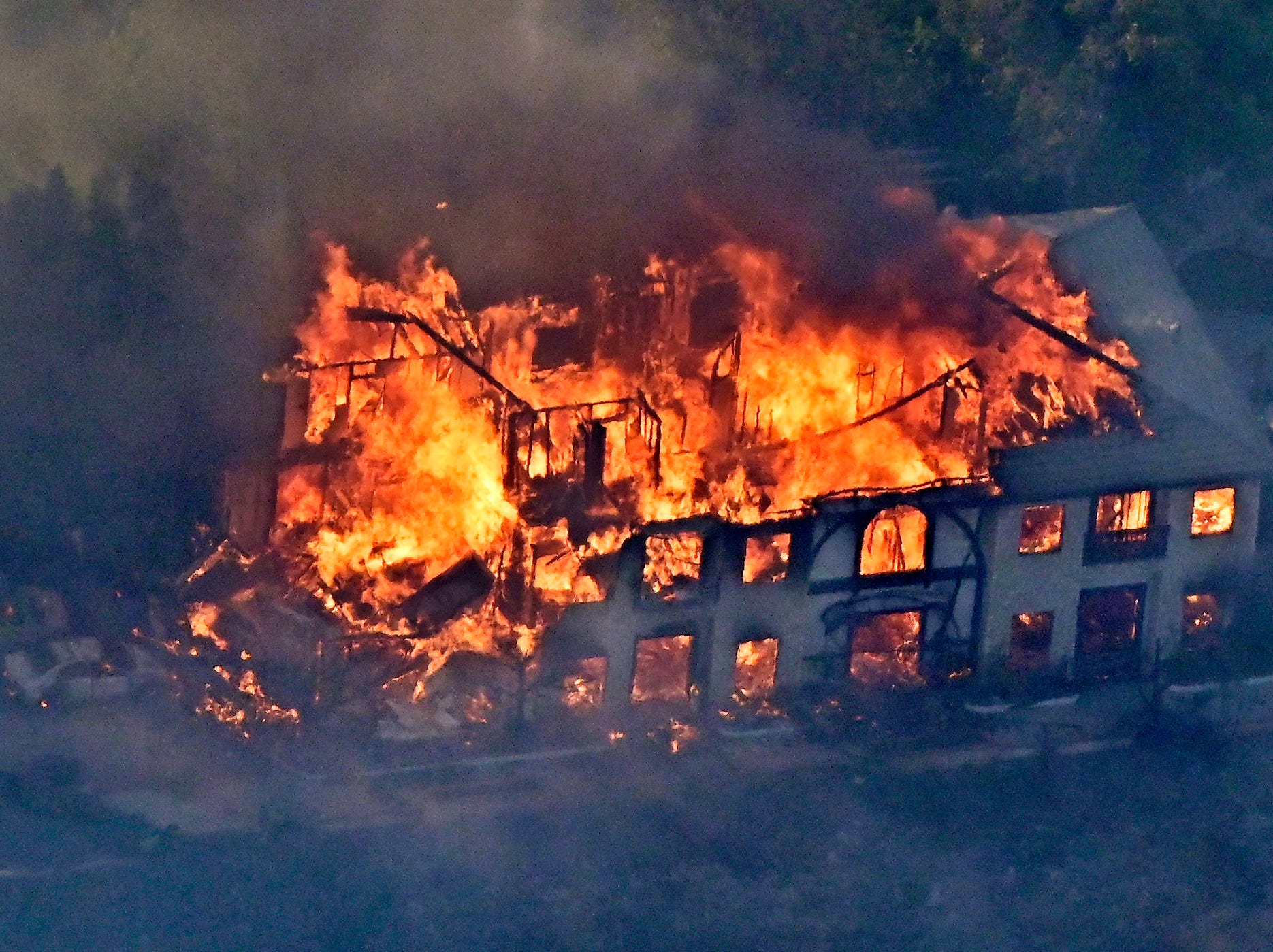 The Woolsey Fire claims a home Friday in Calabasas as it burns toward Malibu after starting a day earlier near Simi Valley.