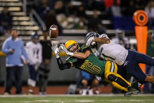 Sierra Canyon's EJ Gable takes down Moorpark wide receiver Jake Mateko during Friday night's Division 3 quarterfinal. Gable was called for pass interference.
