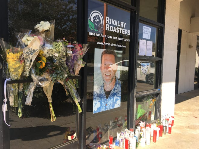 Flowers and candles have collected outside the Simi Valley coffee shop Sean Adler opened over the summer. Adler was one of 12 killed at Borderline Bar & Grill Wednesday night.