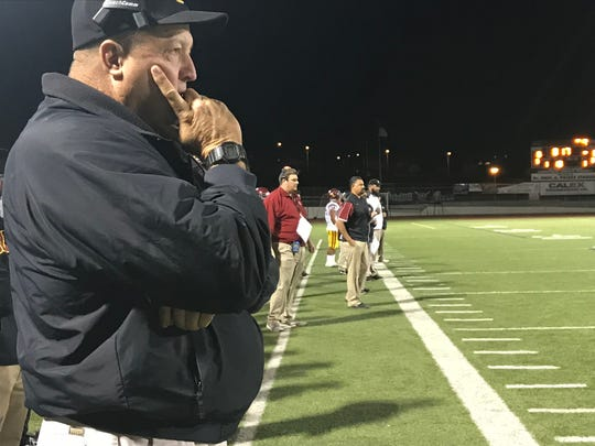 Oxnard High coach Jon Mack (left) and offensive coordinator Tim Gutierrez (background) watch the Yellowjackets' 34-31 win over host Valencia-West Ranch in the CIF-Southern Section Division 6 quarterfinals on Friday night.