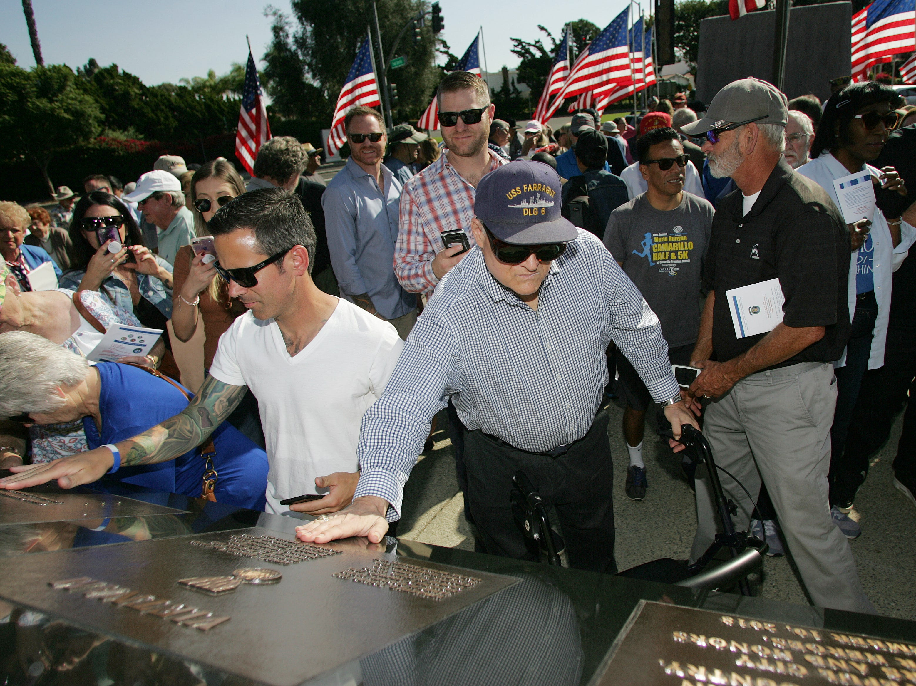 Navy veteran David Minkin, who served in Vietnam, looks at the new veterans monument as Jeff Golden, left, touches the name of his brother Jonathon Golden, an Air Force captain who died in Afghanistan in 2015. The City of Camarillo and American Legion Post 741 hosted a Veterans Memorial Monument dedication ceremony at Constitution Park in Camarillo.