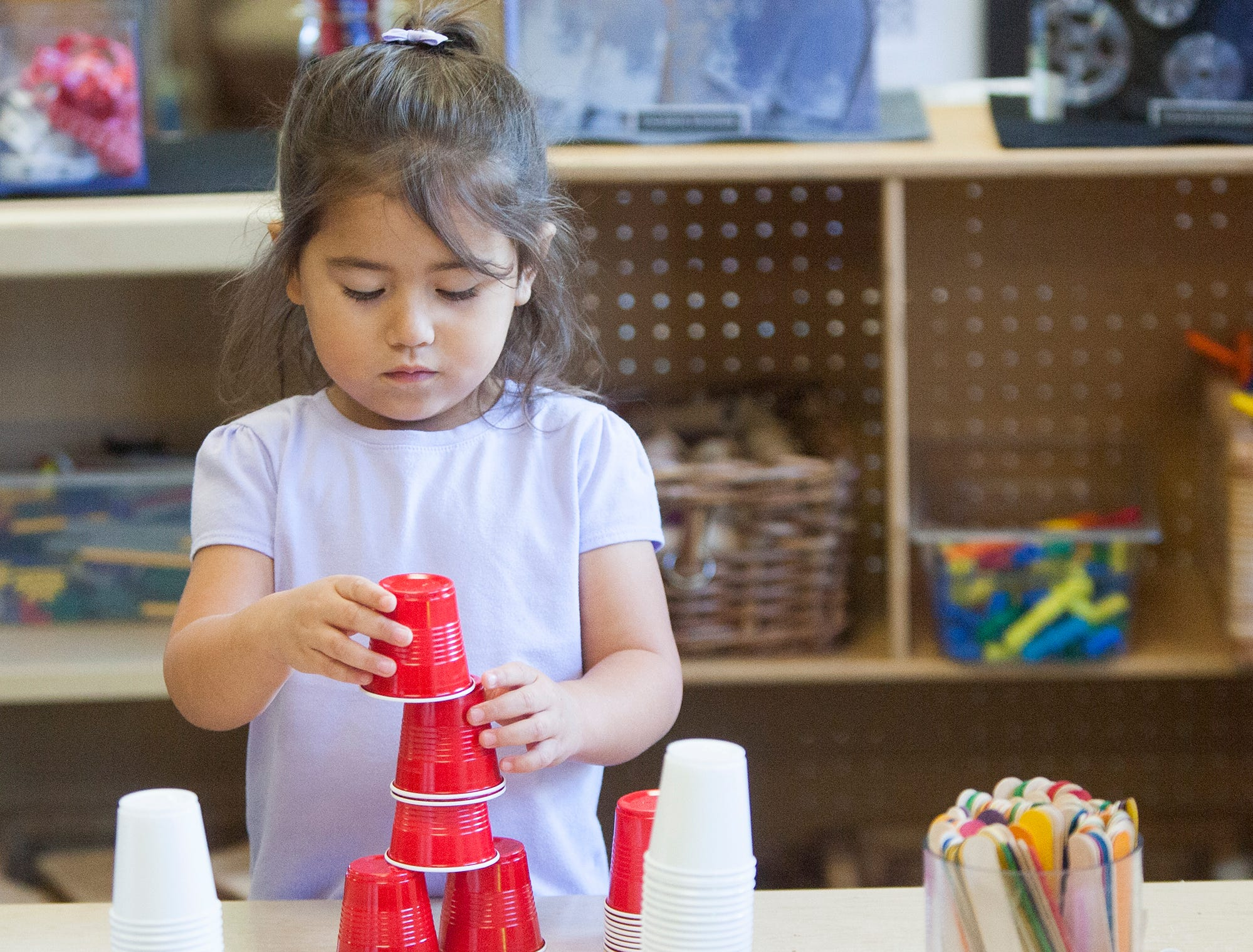 Evelyne works on cup stacking at the Ventura College child care center.