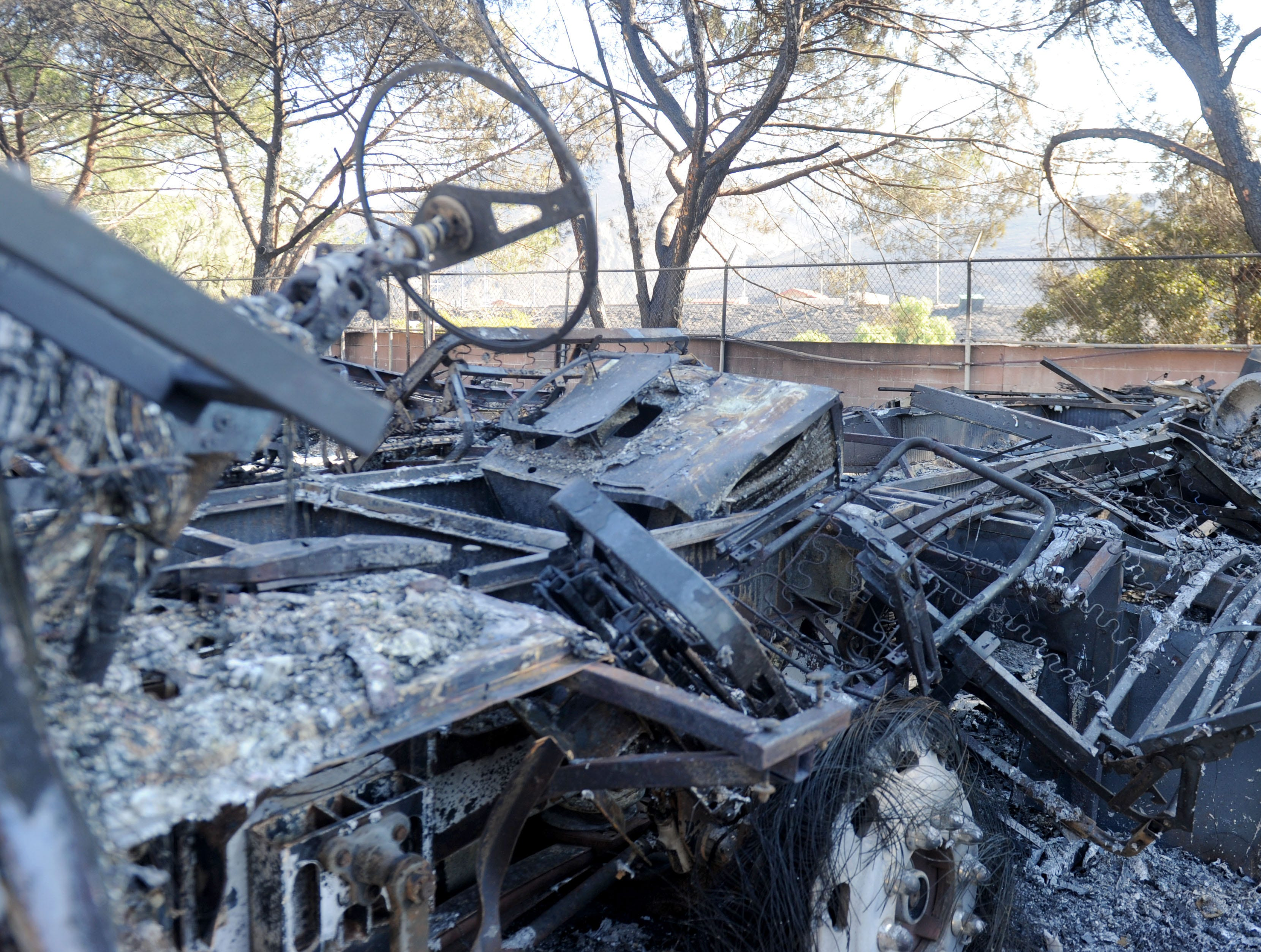Cars and recreational vehicles were burned by the Hill Fire inside the Vallecito mobile home park on Old Conejo Road in Newbury Park.