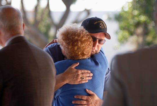 Camarillo Mayor Charlotte Craven hugs Michael McCloud as McCloud and his wife Christine receive a certificate noting the sacrifice of Christine's brother, Marine James Cooney, who lost his life in the Vietnam War. The City of Camarillo and American Legion Post 741 hosted the Veterans Memorial Monument dedication ceremony Saturday at Constitution Park in Camarillo.