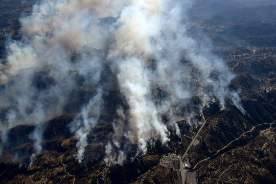 Smoke rises from the Woolsey Fire, as seen from a helicopter over Chatsworth.