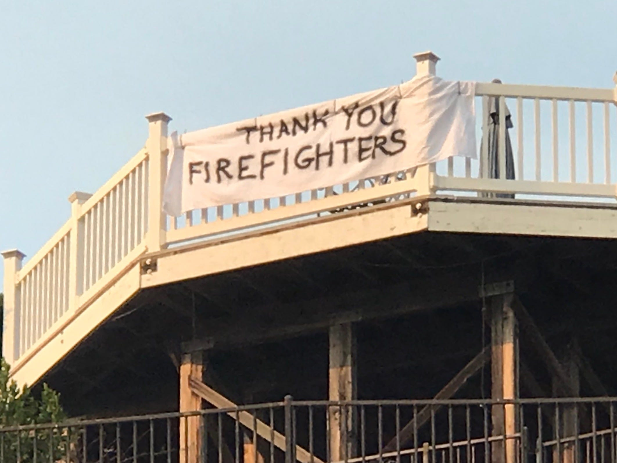 A sign on a home on Glenbridge Road in Westlake Village Saturday thanks firefighters.