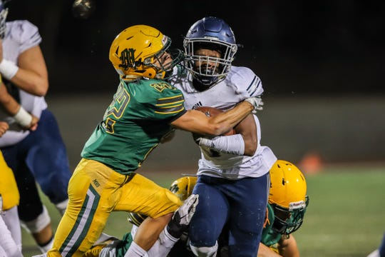 Moorpark's Ethan Gomez tackles Sierra Canyon's Jason Jones Jr. during Friday night's Division 3 quarterfinal.