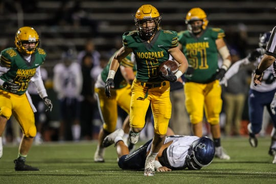 Moorpark's Ian Meier eludes a Sierra Canyon defensive back during Friday night's Division 3 quarterfinal.