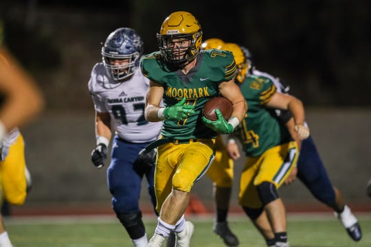 Moorpark's Alec Powell runs away from the Sierra Canyon defense during Friday night's playoff game.