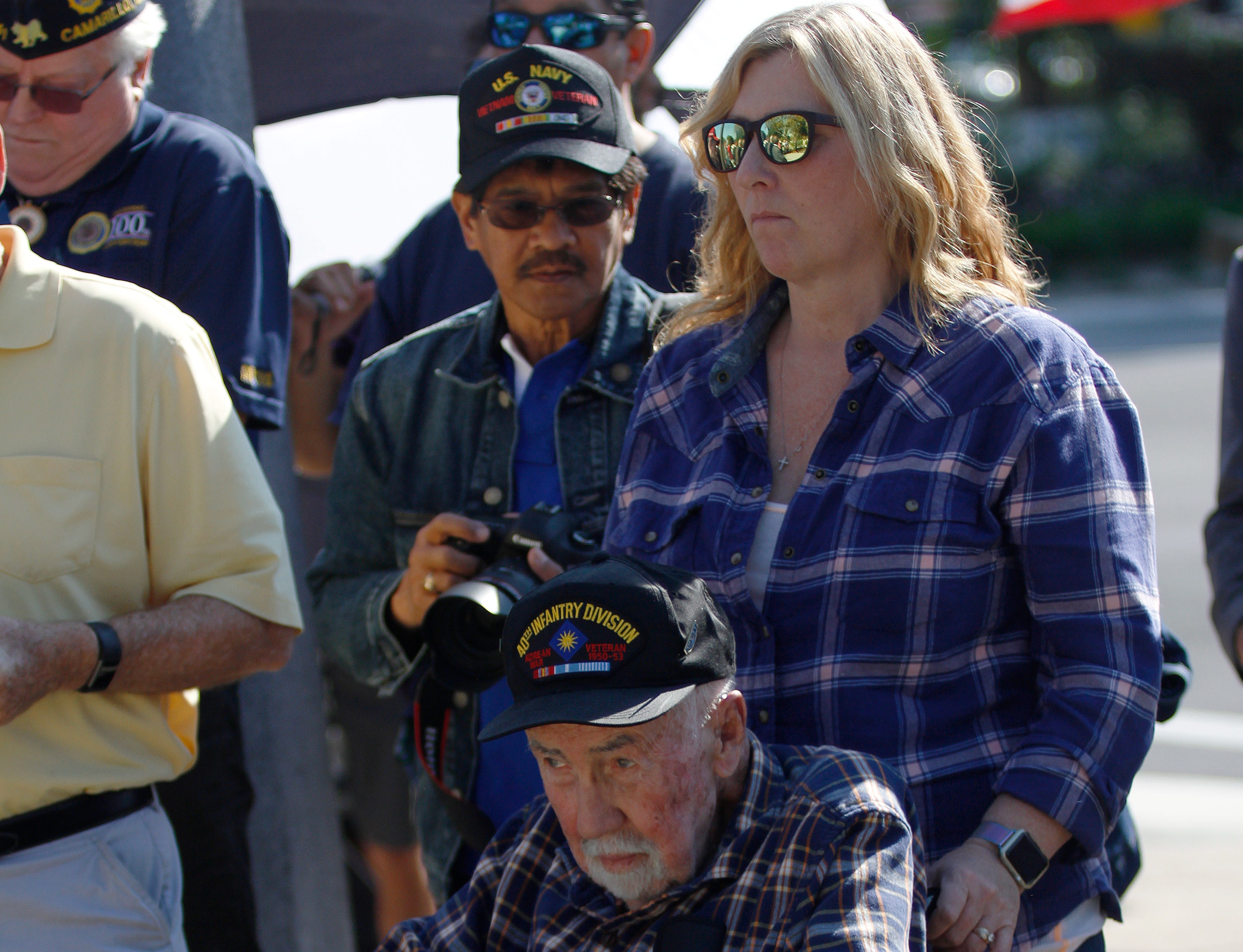 Korean War Army veteran Bob Nunn and Vicky Juengermann watch the unveiling of the new Veterans Memorial Monument on Saturday in Camarillo.