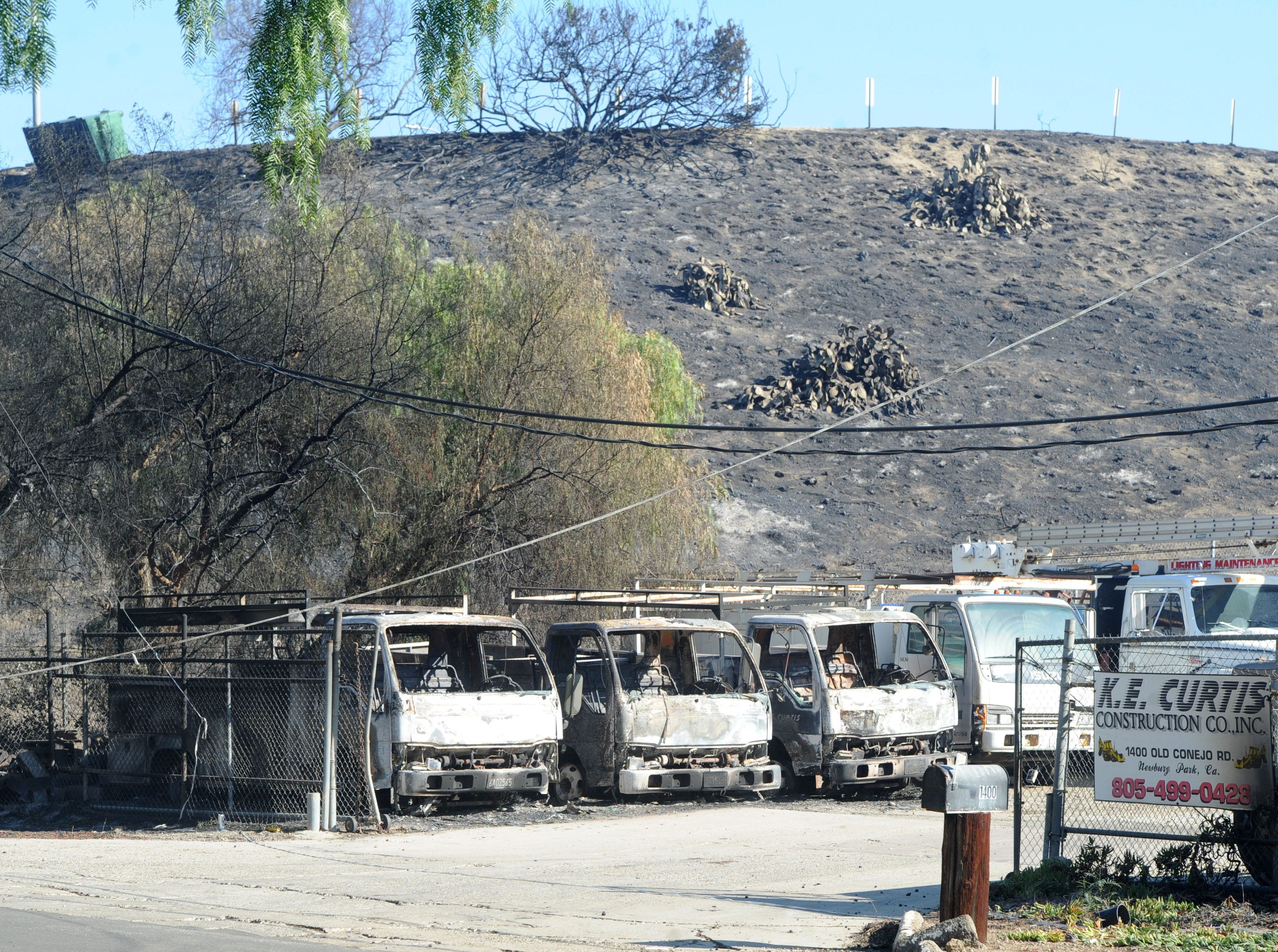 The Hill Fire left some cars burned on Old Conejo Road in Newbury Park.