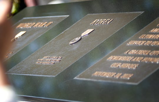 The new concrete and granite veterans monument in Camarillo features brass plaques listing the names of 36 fallen service members from Camarillo and Somis.