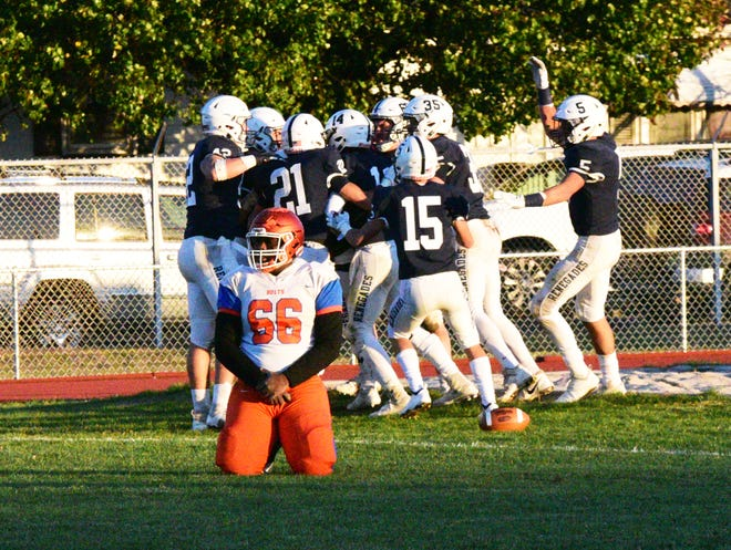 Shawnee players celebrate a touchdown as Millville's Leejon Edwards kneels on the ground during the Renegades' victory over Millville on Saturday, November 10, 2018. Photo/Charles J. Olson