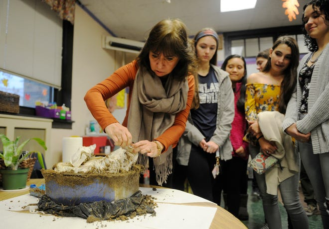 Teacher Veronica Glogau opens a time capsule that her former Bishop Schad students buried 10 years ago.
