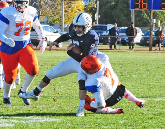 Shawnee's Patrick O'Hanlon, left is tackled by Millville's Shamore Collins after making an interception during the Renegades' victory over Millville on Saturday, November 10, 2018. Photo/Charles J. Olson