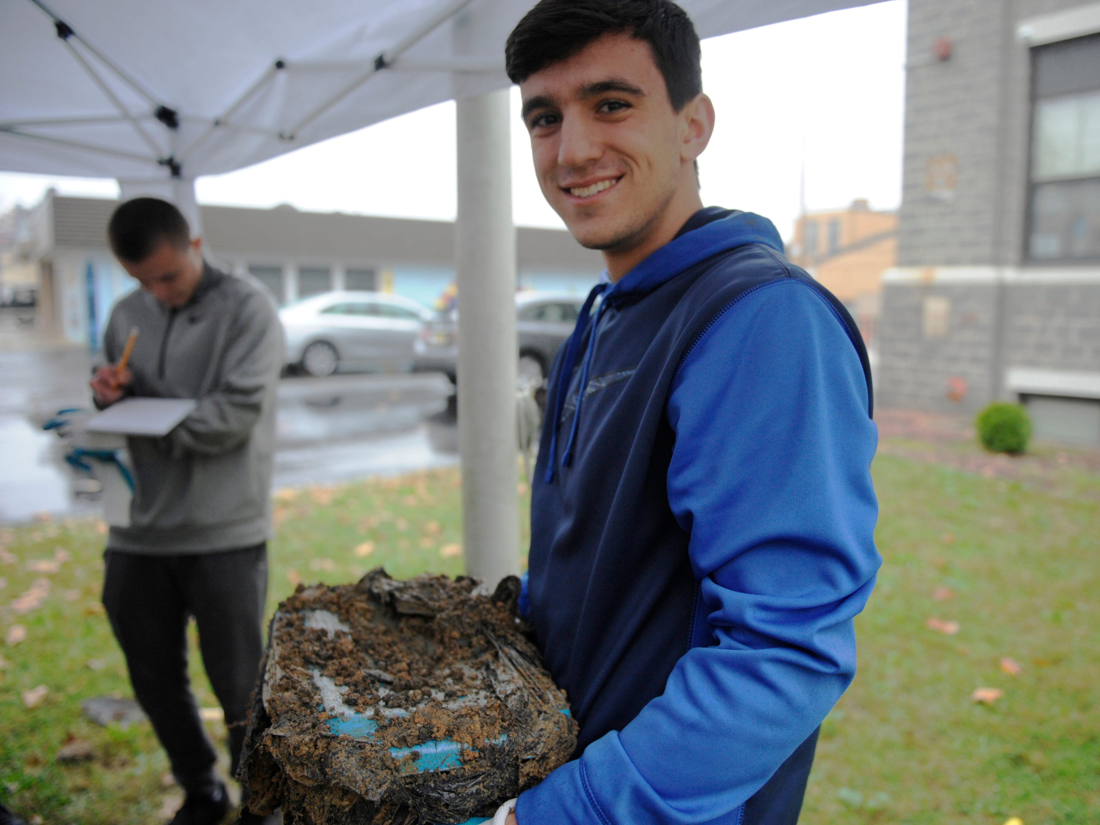 Matt Bernard, a St. Augustine senior, holds a time capsule that his second grade Bishop Schad class buried a decade ago.
