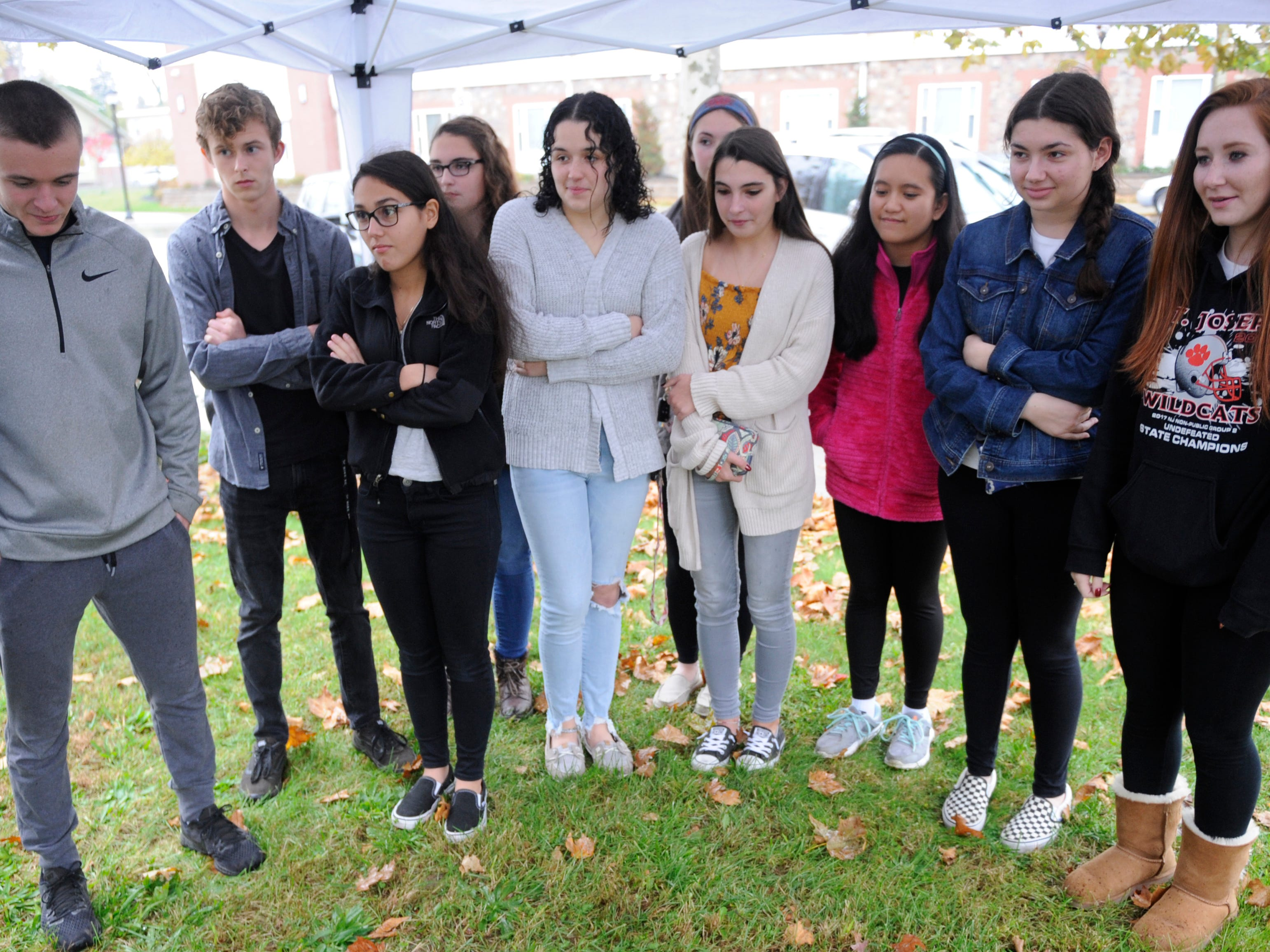 Former Bishop Schad students, now high school seniors, unearth a time capsule that they buried a decade ago in Vineland on Friday, November 10, 2018.