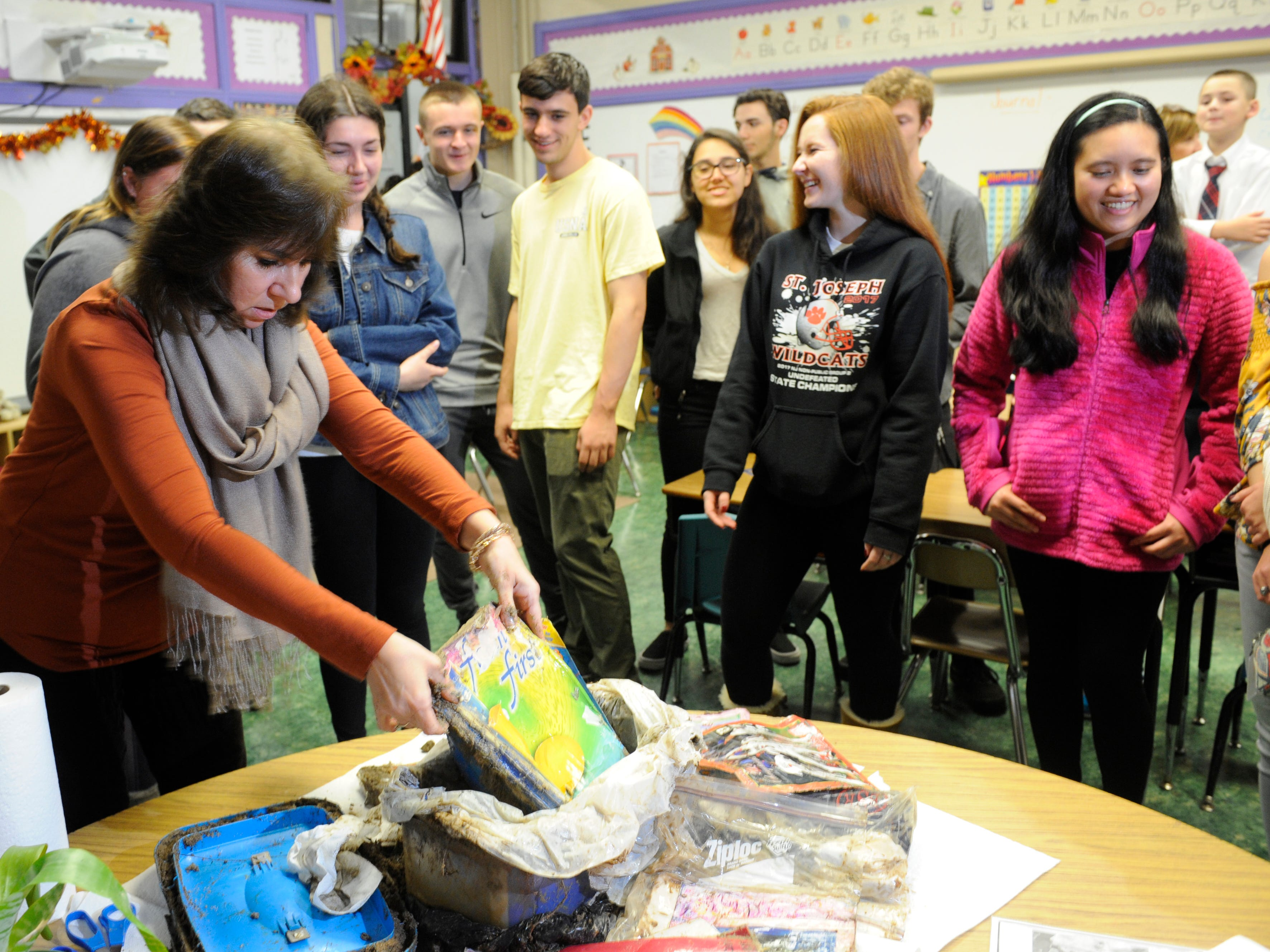 Teacher Veronica Glogau reveals the contents of a time capsule that her former Bishop Schad students buried 10 years ago.