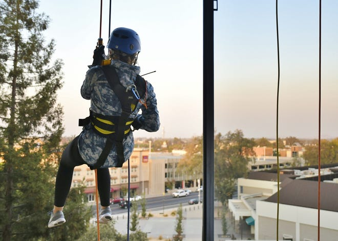 Visalia Times-Delta/Tulare Advance-Register reporter Calley Cederlof goes over the edge for The Source LGBT+ Center on Friday, November 9.