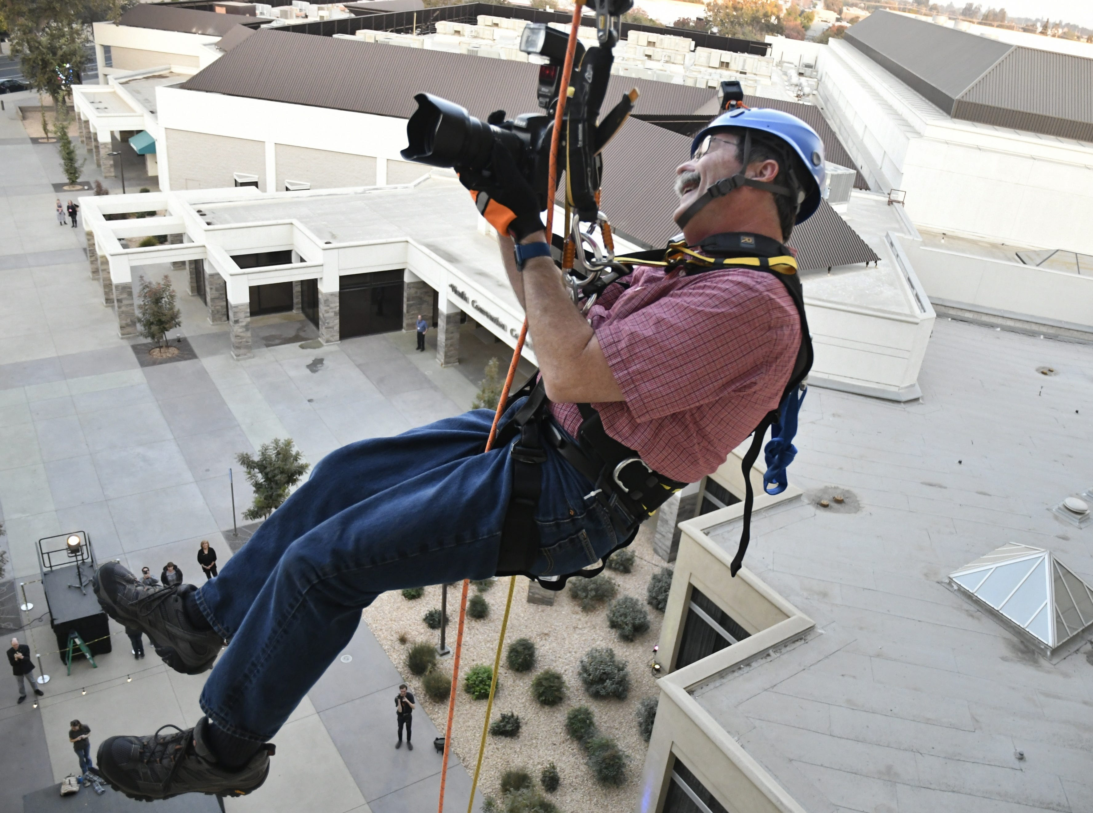 Visalia Times-Delta/Tulare Advance-Register reporter Calley Cederlof and photographer Ron Holman go over the edge for The Source LGBT+ Center on Friday, November 9.