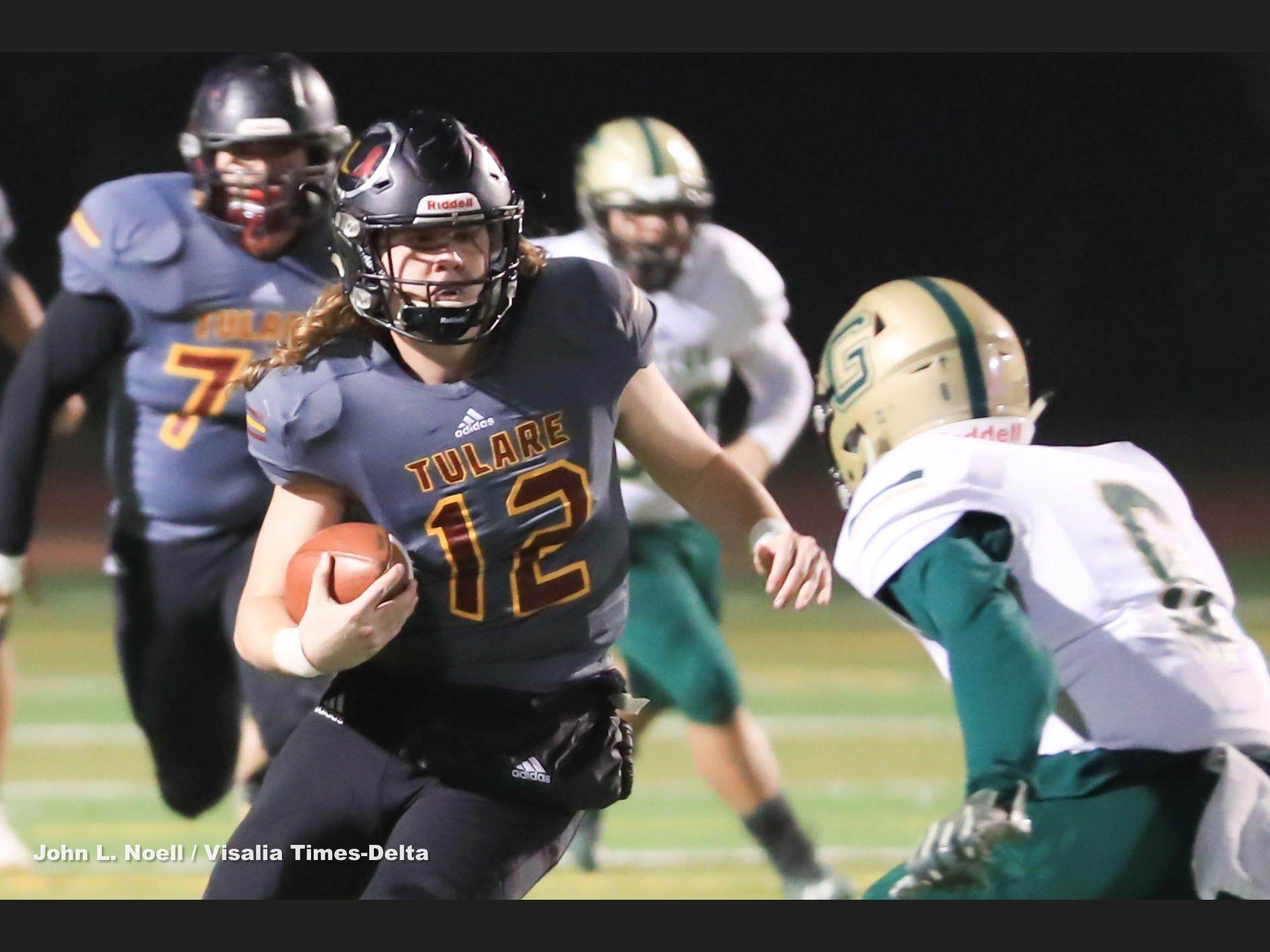 Tulare Union's Nathan Lamb (12) rushes in open field against Garces Memorial in a Central Section Division II quarterfinal high school football game at Bob Mathias Stadium on Nov. 9, 2018.